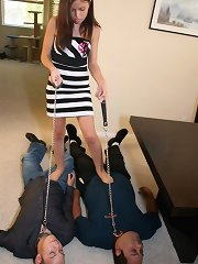 Domina trampled two slaveboys