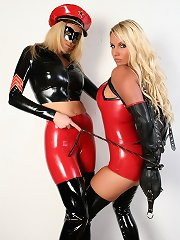 Gorgeous PVC outfits cover those nice-looking golden-haired whores in this shoot