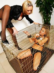This hawt milf taunts this charming blonde in her cage before letting her out for a spanking