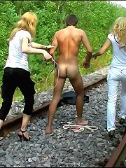 Male was bound and humiliated on the rail road