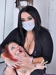 Mistress Jemstone stretches Kaylas clammy pussy hide a speculum