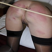Milf chick was caned hard