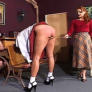 Mistress Gemini executes a cruel caning across a young girls plump young thighs