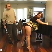 Redheaded tease gets caned for bad behavior