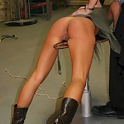 Bitch suspended down and caned