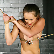 Tied spread out painfully balanced on her cunt