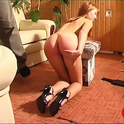 A interesting babe spanked, paddled, caned, down-and-out