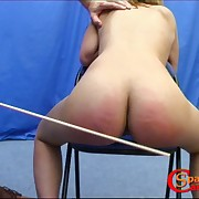 Sexy ebony is bound and spanked vulnerable the sofa