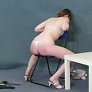 Horny lass gets badly spanked on the chair