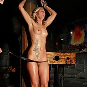 Tied up pretty good cutie with oiled facing gets lashed brutally in the black BDSM area