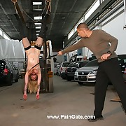 Hot girl Christina suspended to a forklift together with endures an ultra hard bulwhipping even on her sensitive pussy
