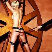 Racy unvarnished blonde is fixed to transmitted to provoking wheel with an increment of lashed