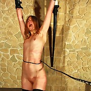 Frying blonde slavegirl Ilka gets hanged up to the brush arms and tortured at the end of one's tether bullwhip as its hardest