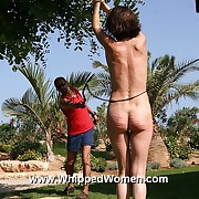 Full force bullwhipping of cute brunettes naked roped synod in an serious outdoor whipping training
