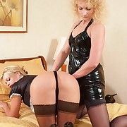 PVC clad bitch spanks her bit of San Quentin quail on all fours on the bed - hot wobbly buttocks