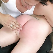 Cheeky housewife spanked on the sofa - burning red buttocks