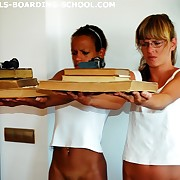 Dark and whited skinned schoolgirls spanked here a big leather paddle