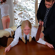 Three young schoolgirls bent over be beneficial to the leather tawse