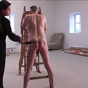 Two naked chaps strapped visciously across their well striped butocks by cruel miss