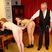2 young schoolgirls lay on spanked and caned