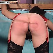 Brunette loveliness stripped bring to light and relentlessly caned on her beautiful bottom