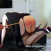 Misbehaving housewife bent intemperance the chair with an increment of caned raw on her full ripe exasperation - canny strokes