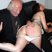Pretty brunette spanked and caned on her heavy ripe ass