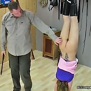 close-fisted booty slut is hung upside down with an increment of paddled