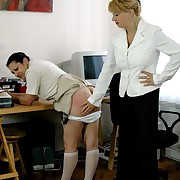 Naked young beauty bent over the desk plus caned hard on will not hear of upturned buttocks