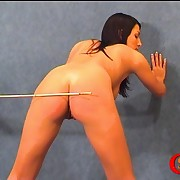 Nice bubble butt gets caned and has gone red