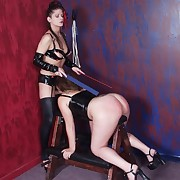 A submissive girl has her cheeks caned well