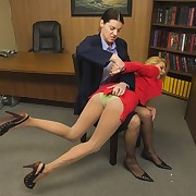Lady spanks her bad girl employee