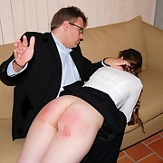 Cute long-haired schoolgirl receives her big round wazoo spanked