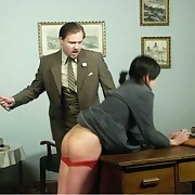 Blonde and brunette gets spanked on the table