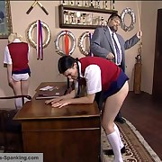 Bent over with her knickers down for a strong detention caning