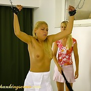 Blonde and redhead gets spanked