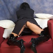 Beautiful dark haired honey with long legs and sexy leather boots on.