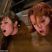 Seda and Lilla are captured and fucked in bondage.