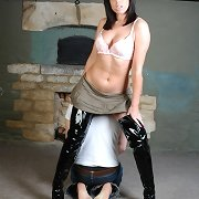This slave gets leather shoes compulsory into his mouth by a beautiful brunette