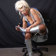 Sexy golden-haired Nicole has a nice-looking couple of silver leather boots on