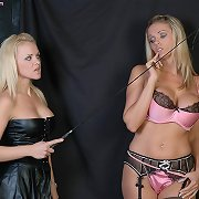 A lustful FemDom in leather punishes a naughty adult baby slut