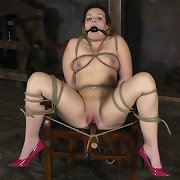Crimped into a hogtie, this babe worms her way toward Mr. Pogo, sucking and fucking her way to the 1st of many orgasms.