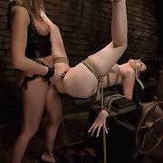 Busty lesbian sexually dominated in bondage.