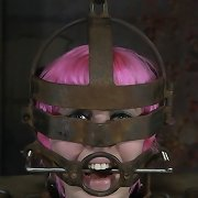 Chick with pink hair tied in metal