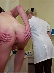 Young female doctors enjoying examination of naked schoolboys