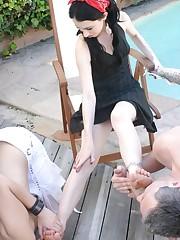 Slavegirl and slaveboy licked mistress` toes outdoor