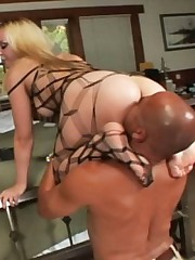 Annette then climbs on the rod iron bedpost and smothers