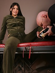 The patient turned foot slave enters a room where Jade is reclining on a bench. Sh....