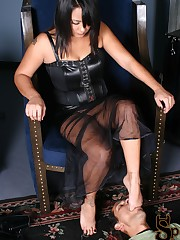 Michelle is sitting in her throne wearing a pair of fetish platform boots.