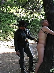 Cowgirl whips bandit tied to tree